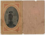 Photograph: tintype in paper sleeve depicting a man and two young women, n.d.